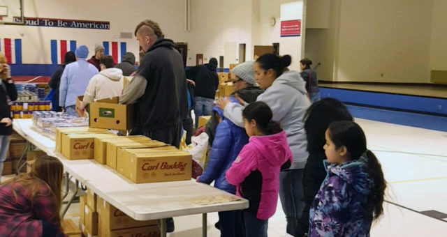 Mobile Marketplace visits local schools, provides food assistance to students and families